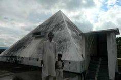 Sri Anjaneya Pyramid Meditation Center year of construction : 2006 size : 30ft x 30ft (roof top) | capacity : 90 persons cost incurred :  9 lakhs | type of structure : RCC timing : 24x7, open for public use technical support : T Muralidhar, +91 9440678866 contact : Kadapa PSSM  mobile : +91 93912 36628, +91 98482 70415 address : Near Jamalapalli, Rayachoty road, CK Dinne (mandal)