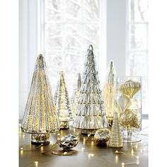 Shop Antiqued Mercury Glass Lit Trees.  These beautiful trees, crafted of antique mercury glass, are battery-operated to lights up the night.