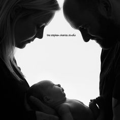 black and white mommy daddy and newborn baby photo