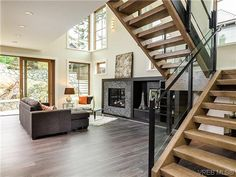 SOLD Abstract Luxury Fairfield House. Signature Abstract staircase, gorgeous windows, radiant floor heating...