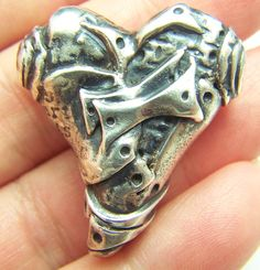 1 Handcrafted Artisan lost wax sterling silver patchwork heart, freeform design bead SRAJ34. $149.99, via Etsy.