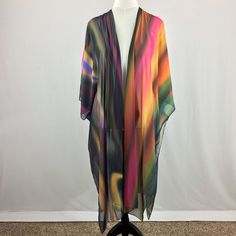 Arizona Sunset Kimono Robe. Arizona Sunset Collection is the latest wardrobe essentials for those over or under fifty who want the ultimate travel outfit separates. Easy care and packing with bold color and design describe this gorgeous collection of #Arizona #sunset color blends. Travel #wardrobeessentials. #travelwardrobe #travelbasics