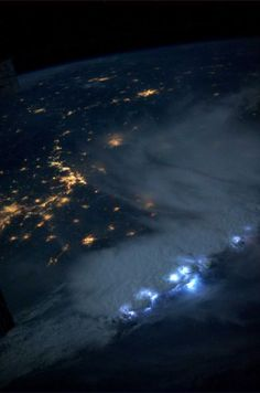"""An impressive line of storms moving through Asia. The lightning was amazing - the most I've seen in a single accumulation of storms."" - Karen Nyberg, July 24, 2013.   PHOTO BY KAREN NYBERG, INTERNATIONAL SPACE STATION"