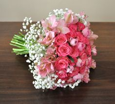 A bouquet for a 4year old birthday girl in pink African roses, pink ranunculus, pink alstroemerias and baby breath.