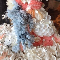 Coffee filters and paper cups transformed to become a coral reef at anthropologie.