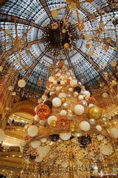"""The outstanding christmas tree at the Galleries La Fayette in Paris. If your list of things to do in Paris features """"shopping"""", this is where you will want to go."""