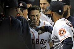 Cool it, Castro - Jason Castro of the Houston Astros is doused with water by teammate Jonathan Villar after hitting a solo home run during the second inning of a game against the San Francisco Giants on May 12 in Houston. - © Eric Christian Smith/Getty Images