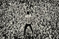 Twenty One Pilots concert in black and white with Tyler being held up by the crowd