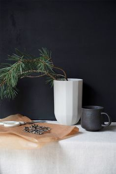 As I'm sure you know by now, my Christmas style is always very simple and minimal, taking inspiration from my Norwegian roots. Minimal Scandinavian Christmas with branches from the garden and Danish Design pieces by Georg Jensen. Christmas collectibles. #nordicchristmas #georgjensen #minimalchristmas