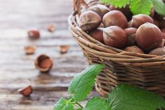 hazelnuts - hazelnuts in a basket on an old wooden background.selective focus.health and diet concept
