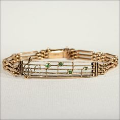 Antique Musical Theme Gate Bracelet with Demantoid Garnet Notes in 15k from vsterling on Ruby Lane