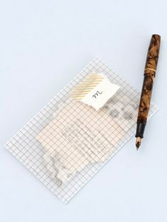 Pretty translucent checked envelopes made from tracing paper, for special notes, personalized with paper and masking tape.