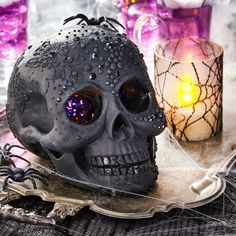 Add glitter, texture and color to a plain skull this Halloween for eerie decor!