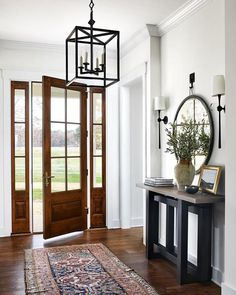 Natural beauty 🌿 featuring the Star Lantern by J. Randall Powers and the Dover Large Tail Sconce by AERIN. Interior design by Porch And Foyer, Entry Foyer, Front Entry Decor, Entrance Hall Decor, Front Entry Tables, Enterance Decor, Entrance Ideas, Estilo Interior, Circa Lighting