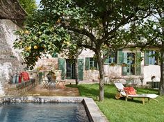 An old stone house has been historically renovated with beautifully preserved and charming details, located in the small town of Spello, in Umbria, Italy. Old Stone Houses, Garden Villa, Balcony Garden, Vacation Home Rentals, House Rentals, Boutique Homes, Tuscan Decorating, Tuscan Style, Tuscan Design
