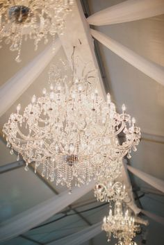 Tent wedding featuring a crystal chandelier by Signature ...