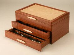 Cascade II Wooden Jewelry Boxes, with sapphire lining and two drawers, are meticulously handcrafted with Bubinga, a rich evergreen tree native to Africa. Jewellery Boxes, Wooden Jewelry Boxes, Woodworking Techniques, Woodworking Plans, Jewelry Box Plans, Drawer Inserts, Wood Projects, Drawers, Decorative Boxes