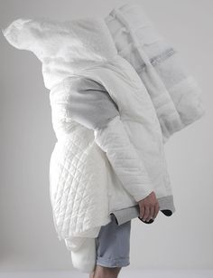 """This wearable cocoon of quilts and blankets by Slovakian architecture graduate Danica Pistekova is just right for people who wish they could take their bed with them in the morning. """"The project is something in between,"""" Pistekova told Dezeen. """"Between fashion and architecture, small and big, private and public, intuitive and logical."""""""