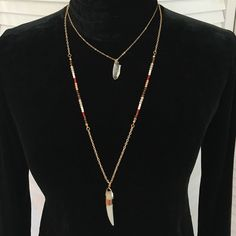 """Gorgeous double-layer necklace w/ """"horn"""" Two gold tone boho necklaces, connected at the lobster clasp. (Cannot be worn separately.) Short necklace has a rustic clear crystal pendant. Long necklace has sections of seed beads in brown, tan, orange, and cream and a good luck """"horn"""" pendant. 3"""" extender. NWOT; never worn. Jewelry Necklaces"""