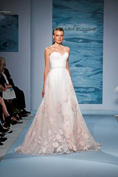 We are obsessed with this Mark Zunino organza gown from @kleinfeld This dress is made for a busty girl.