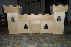 Front of a wooden Castle we made for our daughters Christmas, her magic kingdom!  made of pine, and then all the corners were sanded off with a dremel.