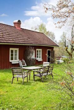 I have a photo of Grandpa Norr's father and his youngest daughter at a table in front of a Swedish cottage just like this.