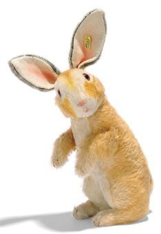 A STEIFF BEGGING RABBIT, (4335,2), ginger and white mohair, wool plush face, brown and black glass eyes, pink stitching, whiskers, felt lining to ears, swivel head, jointed arms, squeaker and FF button with yellow cloth tag, circa 1940 --12in. (30.5cm.) high