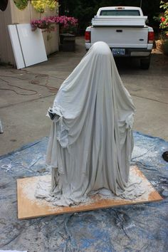 part 2: draping fabric on form after dipping it in monster mud