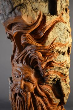 http://www.etsy.com/shop/SusanAlexanderCarves  His hair is carved to reflect his tree branches swaying in the wind.