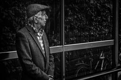 https://flic.kr/p/tSSLAG | Waiting | This is the first image I shot on my trip to Cambridge. A well dressed mature man.