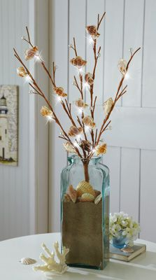 Did something like this, but I like mine a little better........ still getting closer. Love the sand idea. Beach Seashell LED Lighted Branch Decorations