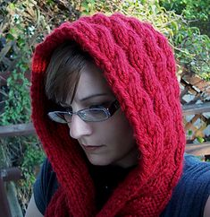 This is a long hooded scarf with pockets. The cable pattern is staggered to create a cascading effect. The cable pattern is simple, easily memorized and you can keep track of where you are at in the pattern by just looking at the cables, so there is minimal row counting involved.