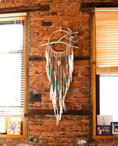 This one looks more native than other designs. Instead of strings in the loop, a Y-shaped twig is placed. Then hanging below are leather strings with feathers. The accent of the dream catcher is floral piece in the side.