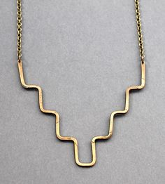 Long Minimalist Brass Necklace | Equal parts dainty and tough, this hammered brass necklace pra... | Necklaces