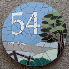 Mosaic house number; mosaic house sign/plaque; variety of sizes, colours and themes available, eg the view from the house!