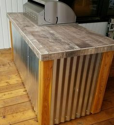 """Sunset Outdoor Living, LLC. 503-831-4677 www.SUNSETOUTDOORLIVING.com We build custom outdoor kitchens in our facility and then deliver and install. Cedar wood with corrugated metal and stainless steel drawers, 32"""" grill custom created by Sunset Outdoor Living. 503-831-4677 call for questions & quotes"""