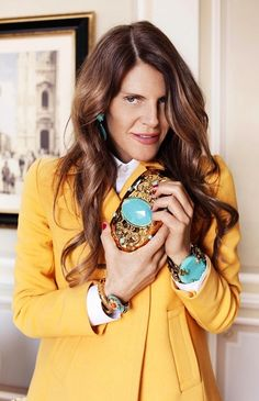 "Anna Dello Russo Born on April 16,196 in Bari, Italy, is the editor at large and creative consultant for Vogue Japan. She spent 18 years at Condé Nast Italia as Fashion Editor at Vogue Italia and serving as Editor of L'Uomo Vogue from 2000-2006, she is currently living in Italia, Milan. She is described as a ""passionate fashionista"" and has been described by Helmut Newton as a ""fashion maniac"". Dello Russo is often featured in popular street style blogs The Sartorialist and Jak & Jill. She…"