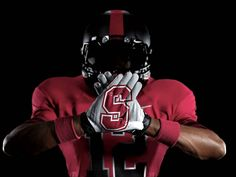 The Stanford Cardinal will debut Nike Pro Combat uniforms against the Notre Dame Fighting Irish Thanksgiving weekend with a black helmet and crimson red uniform look. College Football Gloves, Football Uniforms, Sports Uniforms, Football Helmets, Nike Football, Stanford Football, Stanford University, Nike Pro Combat, American Football
