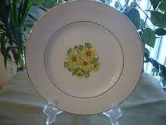 "Collectible Staffordshire Porcelain from England in ""Springtime"" pattern w/ gold rim.  NICE.  No chips, no cracks, no scratches.  Beautiful yellow flowers adorn this nice plate.  7"" in diameter."