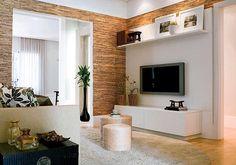 O poder de transformação das texturas. Olha só o destaque que o móvel da TV ganhou com a utilização desse papel de parede com textura de palhinha. Ficou perfeito.