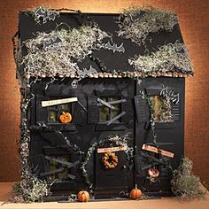 Make a spooky haunted house from a thrift store dollhouse