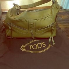 """Gently used JP Tod's shoulder bag. Gently used JP Tod's Mickey shoulder bag.  Great condition.  Minimal scuff marks on bottom corners. Soft leather and great neutral beige.  Has original dust bag. Bag is approximately 12 """"width 8 """" height 4""""1/2 base, strap 12.5"""" Tod's Bags Shoulder Bags"""