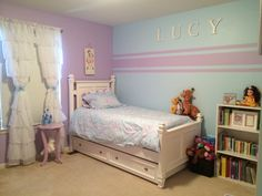 Accent wall stripes for little girl room. Kristin duvet set Pottery Barn Kids. Blue paint Soar from Sherwin-Williams Blue and purple. #big girl room ideas