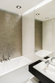 The shiny wall An easy way to bring some shine and glam into your bathroom is by making a metallic wall next to your bathtub. Along with it, pick minimal objects and other silver detail to have a balanced space