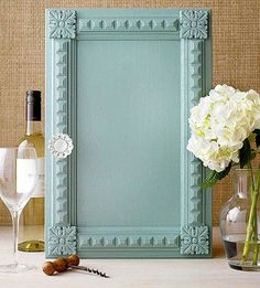 Trimwork on Parade ~ Add interest to a plain cabinet door by parading pretty trimwork around the door's perimeter.