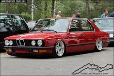 Red 1986 BMW E28 520i on airride and AC-Schnitzer Type 1 wheels - Elmar Den Exter