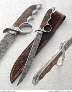"""Heirloom (Bowie) 12"""" blade made from a loaded canister of 1084 and 15n20 pure nickel, 4600e, and 1095 powder metals. One piece guard and handle forged and milled from round stock 416 stainless. Matching scales of Turkish Walnut"""