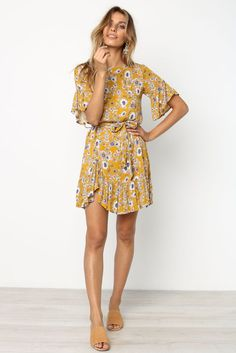 floral print wide sleeve belt loops with detachable waist tie ruffle hem that curves up at front wide round neckline lined material -rayon length of size worn
