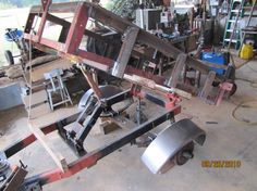 Dump Trailer by Army grunt -- Homemade dump trailer constructed from tubing, an axle, and electric winch. http://www.homemadetools.net/homemade-dump-trailer-3