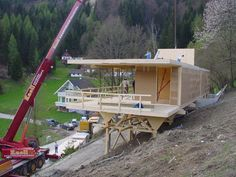 Cross Laminated Timber (CLT) construction in Austria… Pole House, Hut House, Woodland House, Forest House, Houses On Slopes, Prefab Cabins, Casas Containers, Hillside House, House On Stilts